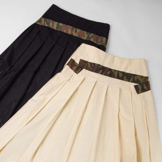 COMME DES GARCONS CAMO SWITCHED PLEATS SKIRTS